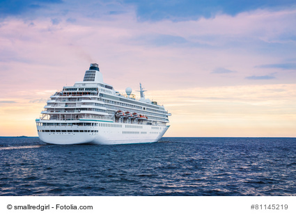 Big cruise ship in the sea at sunset