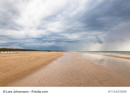 Beach at Lokken in Denmark with dark storm clouds